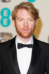 © Licensed to London News Pictures. 14/02/2016. London, UK. DOMHNALL GLEESON arrives on the red carpet for the EE British Academy Film Awards 2016 after party held at Grosvenor House . London, UK. Photo credit: Ray Tang/LNP Photo credit: Ray Tang/LNP