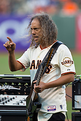 SAN FRANCISCO, CA - MAY 03:  Recording artist Kirk Hammett of Metallica performs the national anthem before the game between the San Francisco Giants and the Los Angeles Dodgers at AT&T Park on May 3, 2013 in San Francisco, California. The San Francisco Giants defeated the Los Angeles Dodgers 2-1. (Photo by Jason O. Watson/Getty Images) *** Local Caption *** Kirk Hammett