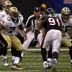 August 21, 2010; New Orleans, LA, USA; New Orleans Saints guard Jahri Evans (73) and center Jonathan Goodwin (76) block against Houston Texans defensive tackle Amobi Okoye (91) during the first quarter of a preseason game at the Louisiana Superdome. Mandatory Credit: Derick E. Hingle