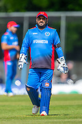 Afghan wicketkeeper Mohammad Shahzad in the field during the One Day International match between Scotland and Afghanistan at The Grange Cricket Club, Edinburgh, Scotland on 10 May 2019.