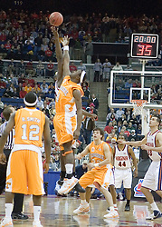 Virginia Cavaliers center Tunji Soroye (21) fights for the opening tip off with Tennessee Volunteers forward Wayne Chism (4) .  The #4 seed Virginia Cavaliers were defeated by the #5 seed Tennessee Volunteers 77-74 in the second round of the Men's NCAA Tournament in Columbus, OH on March 18, 2007.