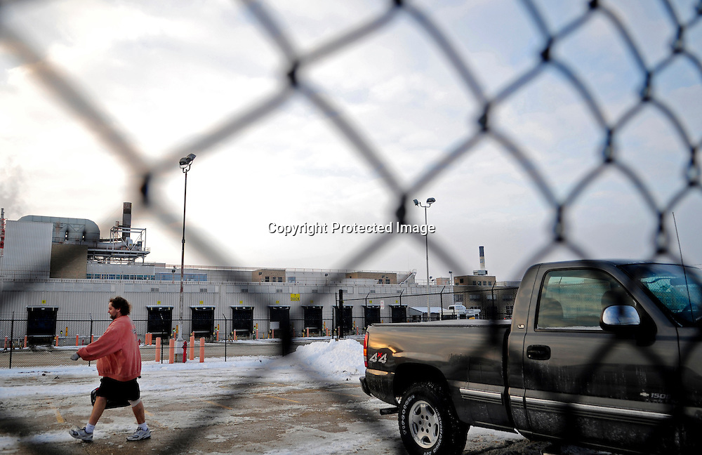 General Motors employees leave the  Janesville Assembly Plant at the end of the work day.