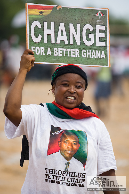 A supporter of the National Democratic Congress (NDC), Ghana's official opposition party, holds a sign promoting change atop her head during at a rally in Tema, roughly 30km east of Ghana's capital Accra on Friday December 5, 2008. Ghanaians are voting in a presidential election on December 7 as incumbent John Agyekum Kufuor, leader of the New Patriotic Party (NPP),  is to step down after ruling for 2 consecutive 4-year terms.