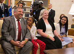 Joshua Holt's father Jason Holt(left), daughter Marian Leal (2nd left), mother Laurie Holt(2nd right) and spouse Thamara Caleño listen during a meeting with Holt and United States President Donald J. Trump upon his return to the U.S. at The White House in Washington, DC, May 26, 2018. Holt, was released from prison in Venezuela following diplomat efforts by the Obama and Trump administrations. Photo by Chris Kleponis/CNP/ABACAPRESS.COM