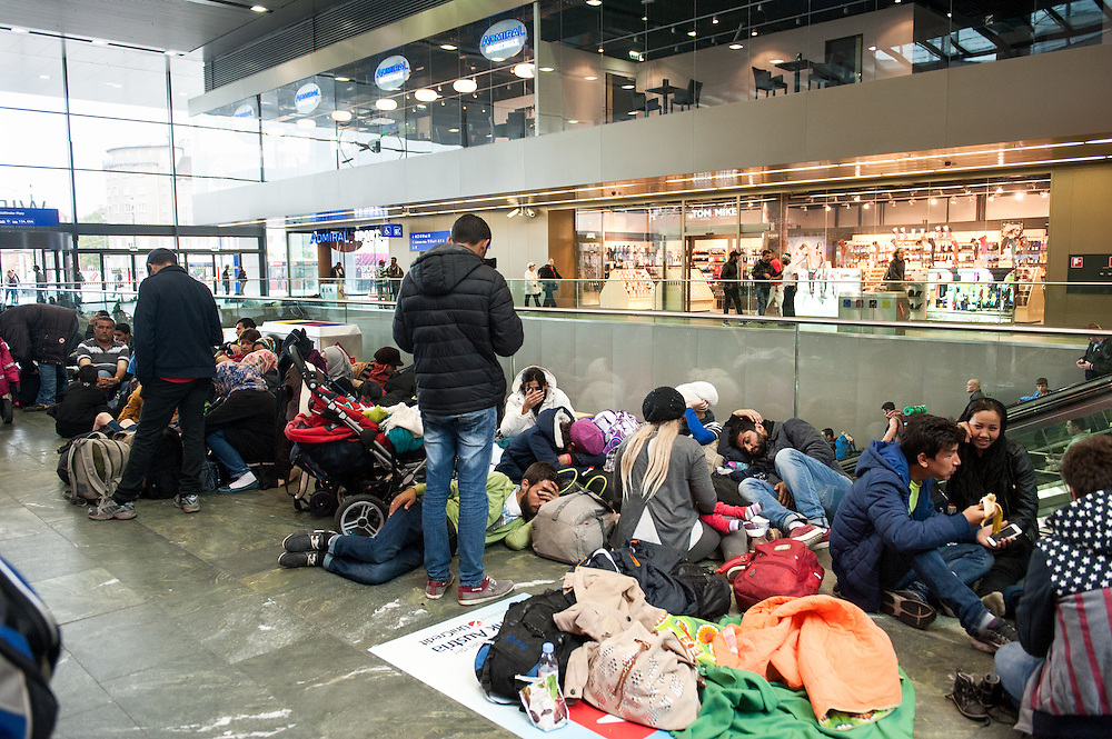 Morning, Tuesday 15th of September 2015. At the central station of Vienna there is a huge queue of refugees and migrants waiting to buy a ticket to Germany. Their families and friends are sleeping everywhere at the station. Hundreds of exhausted people.