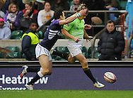 LONDON, ENGLAND - Saturday 10 May 2014, Mark Richards of South Africa kicks the ball ahead during the match between South Africa and Scotland at the Marriott London Sevens rugby tournament being held at Twickenham Rugby Stadium in London as part of the HSBC Sevens World Series.<br /> Photo by Roger Sedres/ImageSA