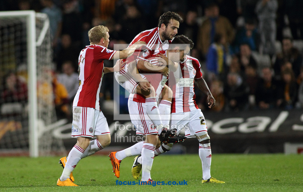 Marc McNulty (R) of Sheffield United  celebrates scoring the 2nd goal against Bradford City during the Sky Bet League 1 match at the Coral Windows Stadium, Bradford<br /> Picture by Stephen Gaunt/Focus Images Ltd +447904 833202<br /> 18/10/2014