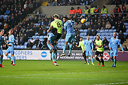 Peterborough United midfielder Mark O'Hara (8) goes close with this header during the EFL Sky Bet League 1 match between Coventry City and Peterborough United at the Ricoh Arena, Coventry, England on 23 November 2018.