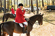 Huntsman Willie Dunn gathers the hounds during the first hunt of the season at Middleton Place Plantation November 27, 2016 in Charleston, SC. Fox hunting in Charleston is a drag hunt using a scented cloth to simulate a fox and no animals are injured.