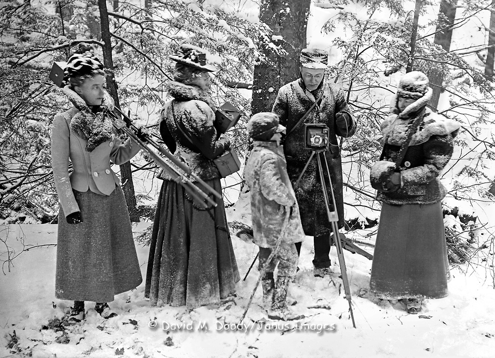 Vintage Photo: Photography class in the snow, circa 1900 Cameras and tripods, men, women and a boy.