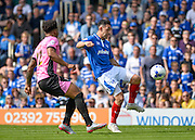 Portsmouth midfielder Gary Roberts and Northampton Town Defender Josh Lelan during the Sky Bet League 2 match between Portsmouth and Northampton Town at Fratton Park, Portsmouth, England on 7 May 2016. Photo by Adam Rivers.