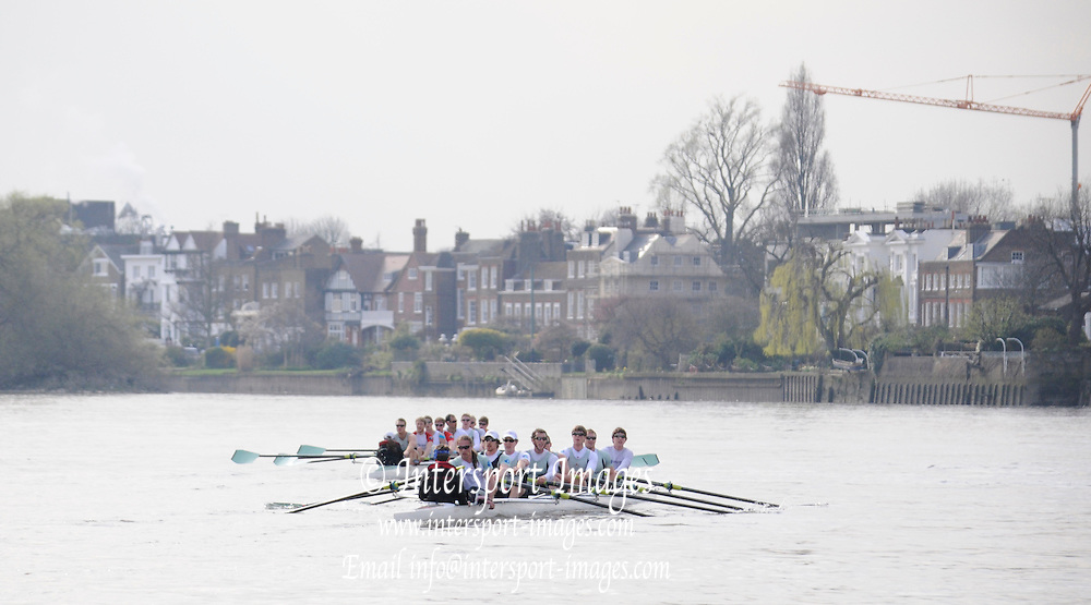 Putney. London. Tideway Week build up to the   2011 University Boat Race over parts of the Championship Course - Putney to Mortlake. Cambridge, CUBC, the Blue Boat, and Isis crew, stop rowing after racing form the Boat Race Start to St Pauls, with the Blue Boat winning. Tuesday 22/03/2011  [Mandatory Credit; Karon Phillips/Intersport-images]..Crews:.CUBC [Blue Boat]. Bow Mike THORP, 2 Joel JENNINGS, 3 Dan- RIX STANDING, 4 Hardy CUBASCH, 5 George NASH, 6 Geoff ROTH, 7 Derek RASMUSSEN, Stroke David NELSON and Cox Liz BOX. . 2011 Tideway Week