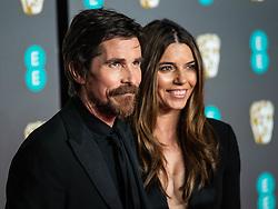 Christian Bale, Sibi Blazic attending 72nd British Academy Film Awards, Arrivals, Royal Albert Hall, London. 10th February 2019
