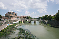 ROME, ITALY - 26 JULY 2017: A view of the Tiber river whose water level has dropped recently, in Rome, Italy, on July 26th 2017.<br /> <br /> A severe drought and sweltering temperatures have led Rome city officials to consider a potential rationing of drinking water for eight hours a day for a million and a half Rome residents. The water crisis has become yet another sign of man being at the mercy of an increasingly extreme climate, but also of once mighty Rome's political impotence, managerial ineptitude and overall decline.Lake Bracciano provides eight percent of Rome's water and has sunk about 1.5 meters