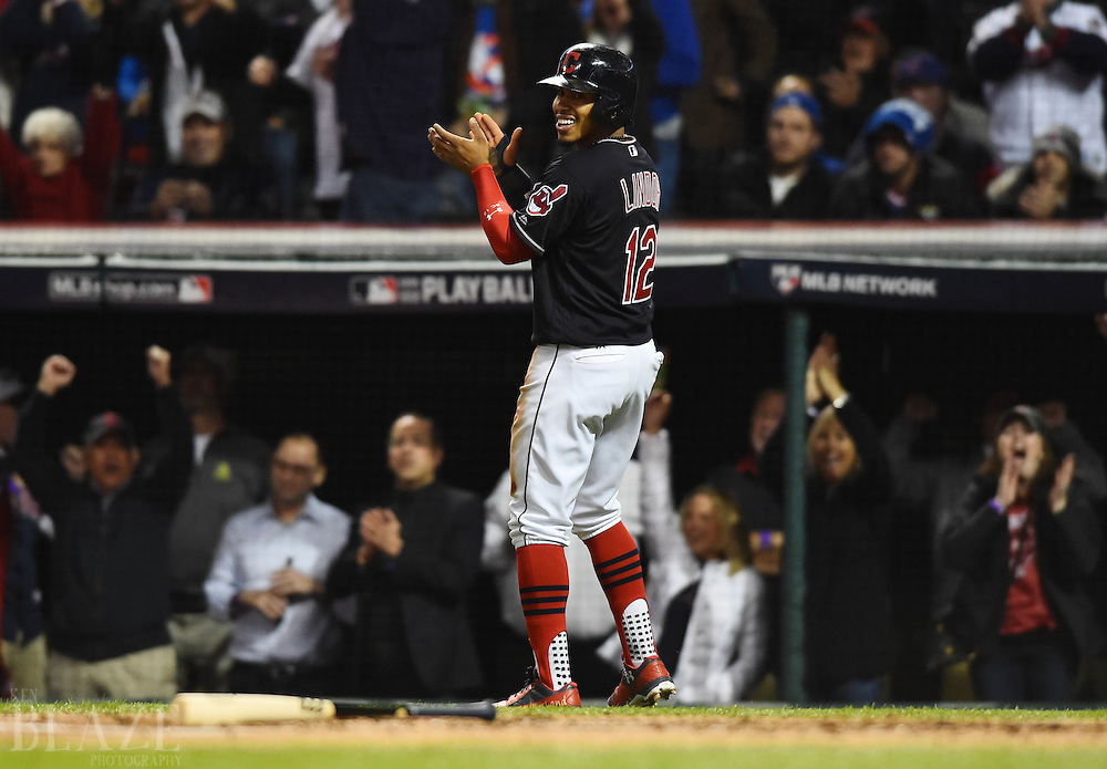 Oct 25, 2016; Cleveland, OH, USA; Cleveland Indians shortstop Francisco Lindor (12) reacts after scoring a run against the Chicago Cubs in the first inning in game one of the 2016 World Series at Progressive Field. Mandatory Credit: Ken Blaze-USA TODAY Sports