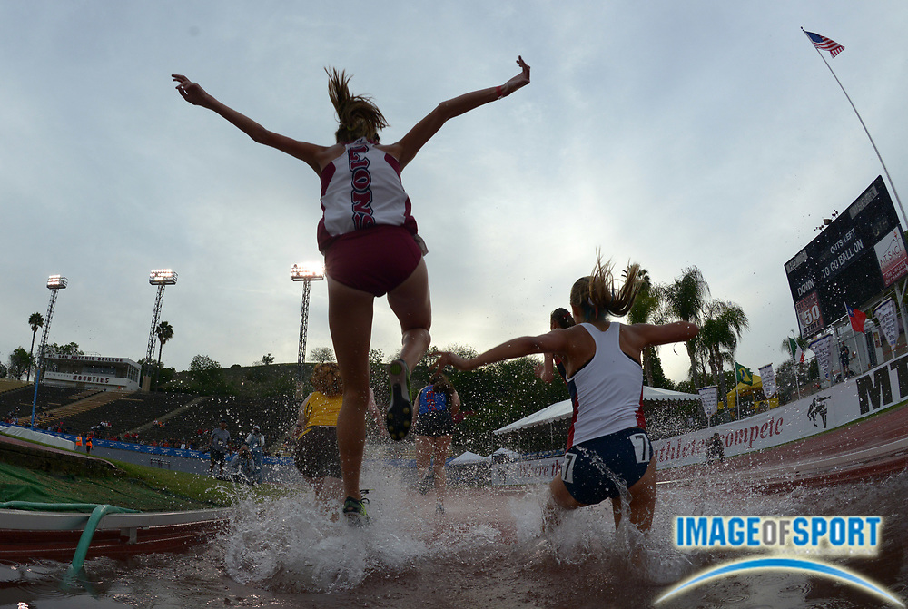 Apr 17, 2014; Walnut, CA, USA; Runners racing over the water jump in the womens steeplechase in the 56th Mt. San Antonio College Relays at Hilmer Lodge Stadium.