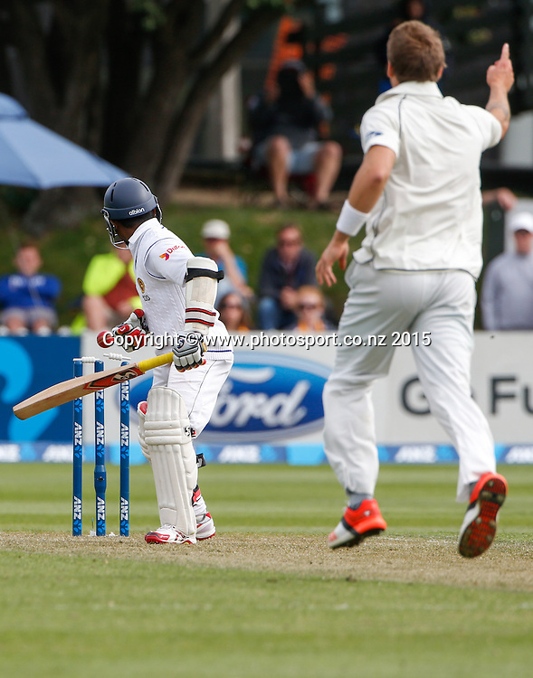 Doug Bracewell and New Zealand celebrate the wicket of Kaushal Silva.  First day, second test, ANZ Cricket Test series, New Zealand Black Caps v Sri Lanka, 03 January 2015, Basin Reserve, Wellington, New Zealand. Photo: John Cowpland / www.photosport.co.nz