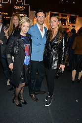 Left to right, ELIZABETH ESTEVE, MARK-FRANCIS VANDELLI and MASHA HANSON at the PAD London 2015 VIP evening held in the PAD Pavilion, Berkeley Square, London on 12th October 2015.