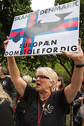 Knightsbridge, London, July 31st 2015. Animal rights activists from Sea Shepherd and other organisations protest outside the Danish embassy in London against the annual slaughter of pilot whales in the Faroe Islands.
