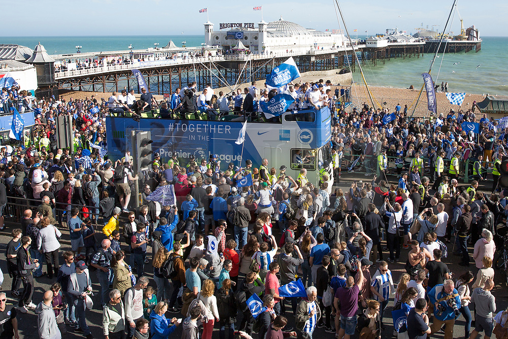 © Licensed to London News Pictures. 14/05/2017. Brighton, UK. The Players of the Brighton and Hove Albion football club celebrate promotion to the Premier League with their fans by holding a parade on the seafront on an open top bus. Photo credit: Hugo Michiels/LNP