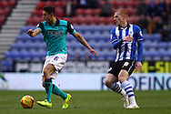 Jason Lowe of Blackburn Rovers gets away from Ben Watson of Wigan Athletic. Skybet football league championship match , Wigan Athletic v Blackburn Rovers at the DW Stadium in Wigan, Lancs on Saturday 17th Jan 2015.<br /> pic by Chris Stading, Andrew Orchard sports photography.