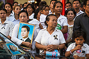 "04 FEBRUARY 2013 - PHNOM PENH, CAMBODIA: Cambodians stand near the National Museum with photos of former Cambodian King Norodom Sihanouk during his cremation service in Phnom Penh. Norodom Sihanouk (31 October 1922 - 15 October 2012) was the King of Cambodia from 1941 to 1955 and again from 1993 to 2004. He was the effective ruler of Cambodia from 1953 to 1970. After his second abdication in 2004, he was given the honorific of ""The King-Father of Cambodia."" Sihanouk died in Beijing, China, where he was receiving medical care, on Oct. 15, 2012.    PHOTO BY JACK KURTZ"