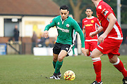 Burgess Hill midfielder Leon Redwood has a shot on goal during the Ryman Premier League match between Merstham and Burgess Hill at Moatside, Merstham, United Kingdom on 31 December 2016. Photo by Andy Walter.