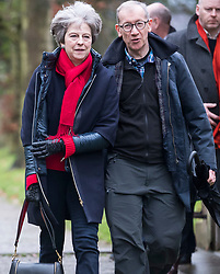 © Licensed to London News Pictures. 31/12/2017. British Prime Minister THERESA MAY attends an early morning church service with her husband PHILIP near her constituency home. Photo credit: Ben Cawthra/LNP