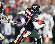 CHICAGO - OCTOBER 16:  Wide receiver Mushin Muhammad #87 of the Chicago Bears gains yardage after a catch against the Minnesota Vikings at Soldier Field on October 16, 2005 in Chicago, Illinois. The Bears defeated the Vikings 28-3. ©Paul Anthony Spinelli *** Local Caption *** Mushin Muhammad