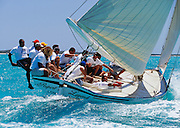 "356204-1161 ~ Copyright:  George H. H. Huey ~  ""Rupert's Legend"", Class ""A"" Bahamian sloop, w/ Mark Knowles at the helm,  sailing to windward at the annual National Family Island Regatta. George Town, Great Exuma Island, Bahamas."