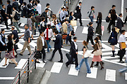 people crossing at a zebra pad in Tokyo Japan