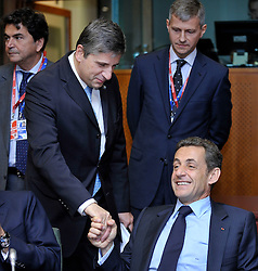 "Nicolas Sarkozy, France's president, right, speaks with Michael Spindelegger, Austria's foreign minister, during the European Union Summit at the EU headquarters in Brussels, Belgium, on Thursday, Oct. 29, 2009. European Union leaders are set for ""very difficult"" talks to overcome the Czech Republic's resistance to a new governing treaty designed to strengthen the EU's influence in world affairs, Reinfeldt said. (Photo © Jock Fistick)"