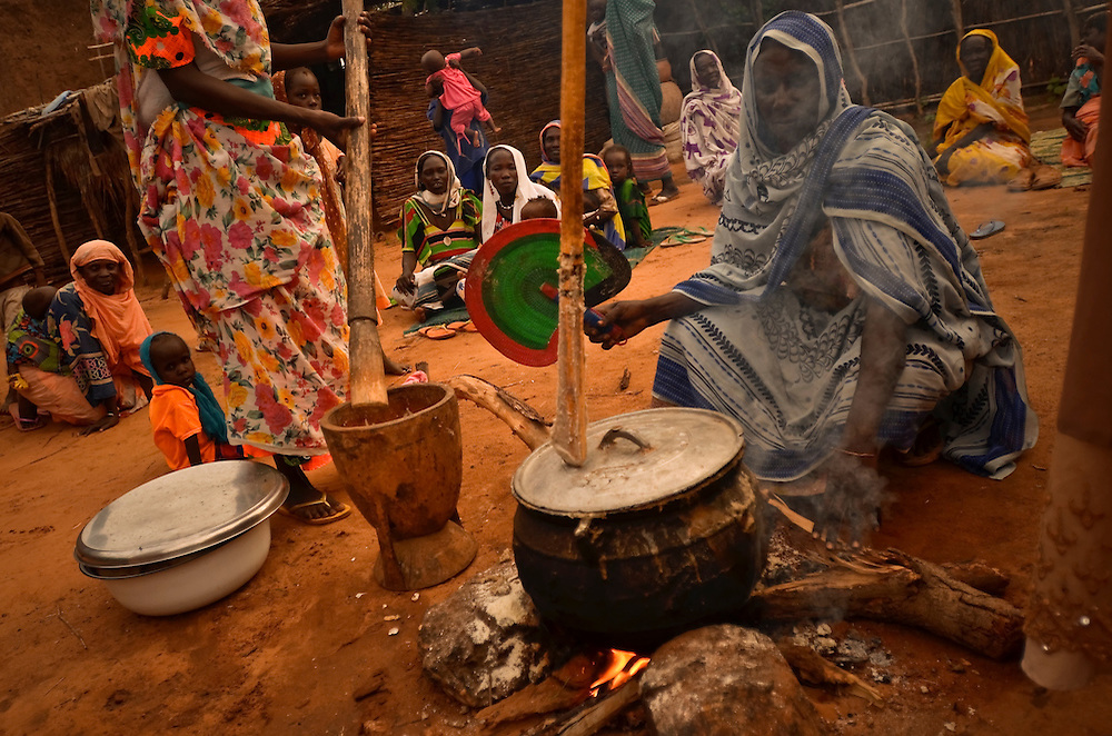 Women cook a Ramadan feast at their home in Djabal refugee camp outside of Goz Beida, Chad.