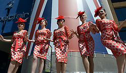 © Licensed to London News Pictures. 19/06/2012. Ascot, UK Singers from the Tootsie Rollers wear matching outfits. Day one at Royal Ascot 19 June 2012. Royal Ascot has established itself as a national institution and the centrepiece of the British social calendar as well as being a stage for the best racehorses in the world.. Photo credit : Stephen Simpson/LNP
