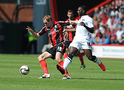 Bournemouth's Shaun Macdonald shields thew ball from Charlton Athletic's Marvin Sordell - Photo mandatory by-line: Alex James/JMP  - Tel: Mobile:07966 386802 03/08/2013 -Bournemouth vs Charlton Athletic  - SPORT - FOOTBALL -  Dean Court-Bournemouth - Charlton Athletic -