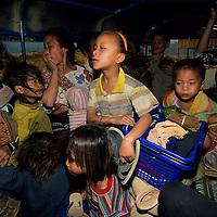 Scene inside crowded Tuk Tuk ride, Muang Singh, Laos
