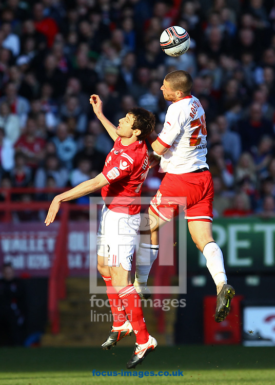 Picture by John Rainford/Focus Images Ltd. 07506 538356.25/02/12.Yann Kermorgant of Charlton Athletic and Michael Bostwick of Stevenage during the Npower League 1 match at The Valley stadium, London.