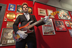 © licensed to London News Pictures. London, UK 28/06/2012. A Fender Precision bass guitar, owned by Roger Waters, founder of Pink Floyd, estimated to be sold for £8,000- 12,000 by Bonhams. The guitar was given to the vendor's late husband who was making improvements to Roger's home in the early 1970s. Photo credit: Tolga Akmen/LNP