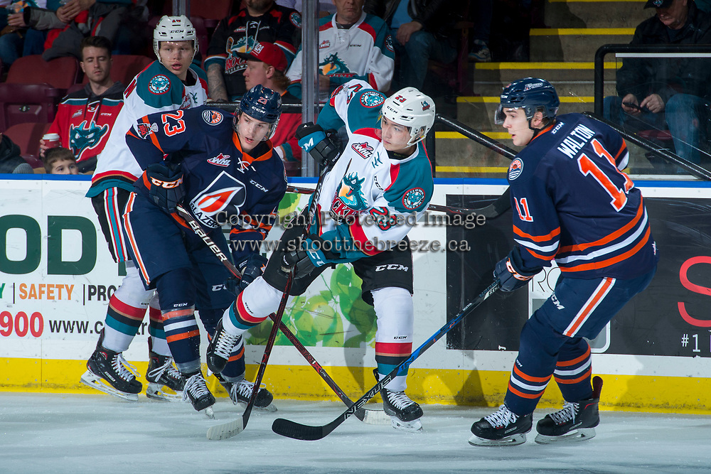 KELOWNA, CANADA - FEBRUARY 24: Colum McGauley #23 of the Kelowna Rockets shoots the puck away from the Kamloops Blazers  on February 24, 2018 at Prospera Place in Kelowna, British Columbia, Canada.  (Photo by Marissa Baecker/Shoot the Breeze)  *** Local Caption ***