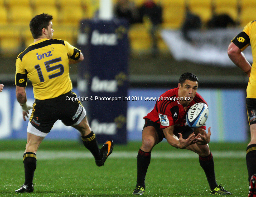 Dan Carter collects Cory Jane's (left) chip kick. Super 15 rugby match - Crusaders v Hurricanes at Westpac Stadium, Wellington, New Zealand on Saturday, 18 June 2011. Photo: Dave Lintott / photosport.co.nz