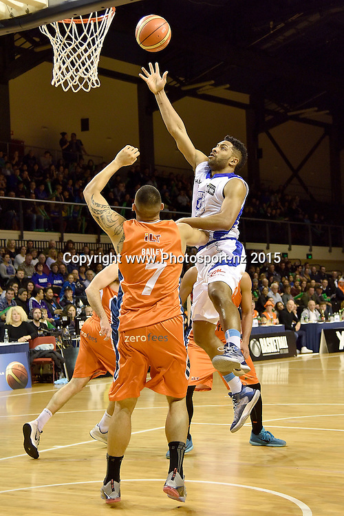 Dion Prewster (R of the Saints jumps to shoot with Duane Bailey of the Southland Sharks during the NBL final basketball match between Wellington Saints and Southland Sharks at the TSB Arena in Wellington on Sunday the 5th of July 2015. Copyright photo by Marty Melville / www.Photosport.nz