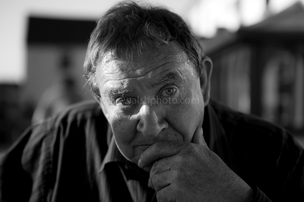 The Da - my father, 3rd June 2011.<br /> <br /> My father, Jim Walsh, photographed in 2010. He passed away due to complications from Dementia, in the closing days of 2017. In this photo, he had already started suffering, and even though he makes direct, piercing contact with the camera - and the photographer, there was already something wrong. This bravado was a mask for his sense of things slipping away, that he wasn't as sure of himself anymore, and was often confused. A few months later, he got himself lost in his car on a dark night in the countryside. I spent hours searching, and eventually finding him.
