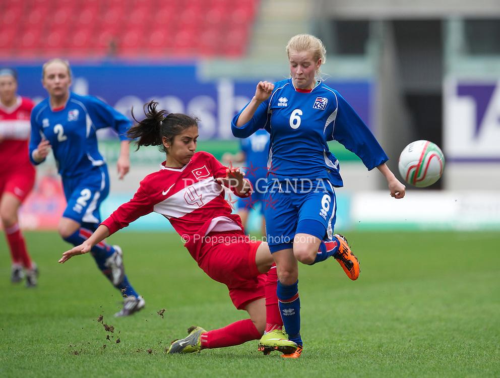 LLANELLI, WALES - Thursday, March 31, 2011: Iceland's Sigrun Ella Einarsdottir and Turkey's Emine Demir during the UEFA European Women's Under-19 Championship Second Qualifying Round (Group 3) match at Parc Y Scarlets. (Photo by David Rawcliffe/Propaganda)