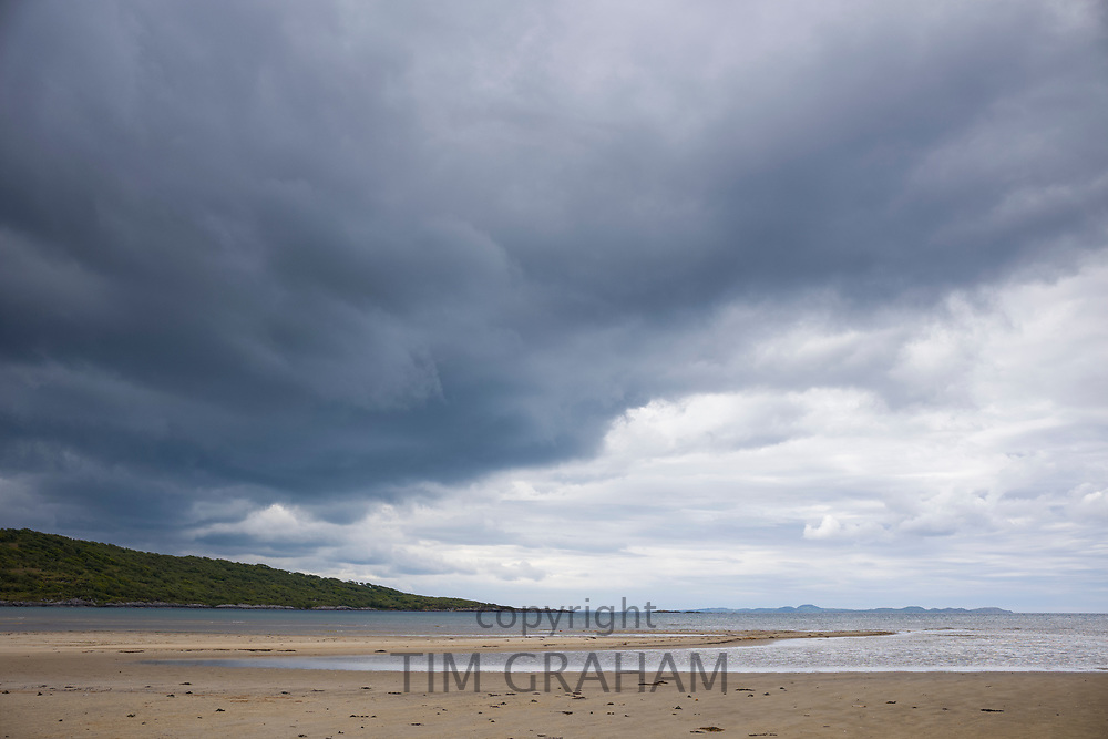 Cumulonimbus clouds rolling over over peaceful sea loch - Loch Stornaway on the Argyll coast, Scotland