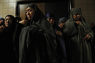 Actors at St. Jerome Catholic Parish in Chicago's Rogers Park neighborhood pray together before reenacting a Via Crucis, portraying the biblical account of Jesus Christ being condemned to death, followed by his crucifixion and entombment.