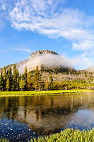 Low clouds / fog settled over Madison River & Mount Haynes at sunrise; Yellowstone NP., WY