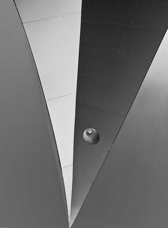 A prow-shaped section of the Walt Disney Concert Hall building looks like the prow of a massive space vehicle cruising overhead.