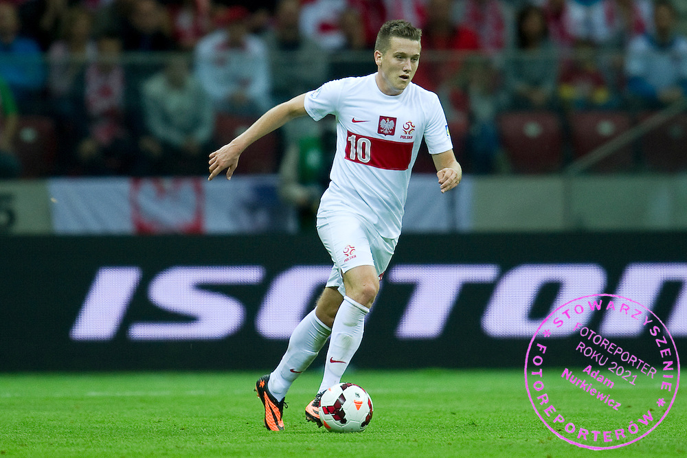Poland's Piotr Zielinski controls the ball during the 2014 World Cup Qualifying Group H football match between Poland and Montenegro at National Stadium in Warsaw on September 06, 2013.<br /> <br /> Poland, Warsaw, September 06, 2013<br /> <br /> Picture also available in RAW (NEF) or TIFF format on special request.<br /> <br /> For editorial use only. Any commercial or promotional use requires permission.<br /> <br /> Mandatory credit:<br /> Photo by &copy; Adam Nurkiewicz / Mediasport
