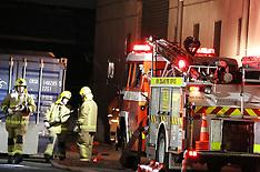 Auckland-Seventeen fire crews fight industrial building fire, Glendene