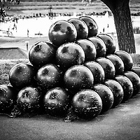 St. Joseph Michigan cannon balls black and white photo. The stack of cannon balls is part of a revolutionary war monument. The photo is high resolution and was taken in 2013. Image Copyright © Paul Velgos All Rights Reserved.